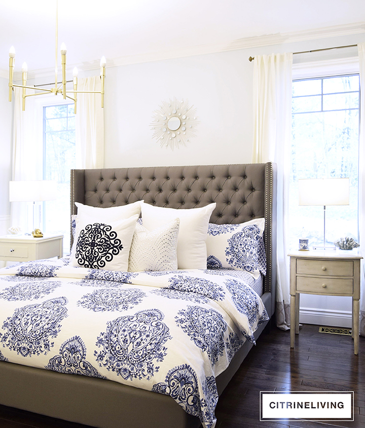 A pale blue, brass and grey color palette is serene and relaxing for a master bedroom retreat.