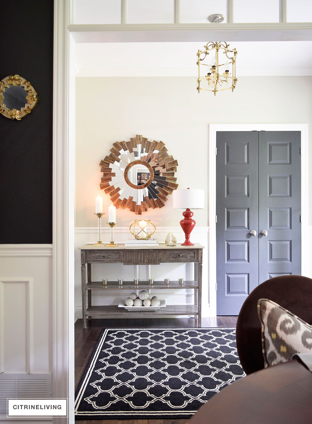 Fall decorated entryway with neutral and metallic decor and a punch of color for visual interest