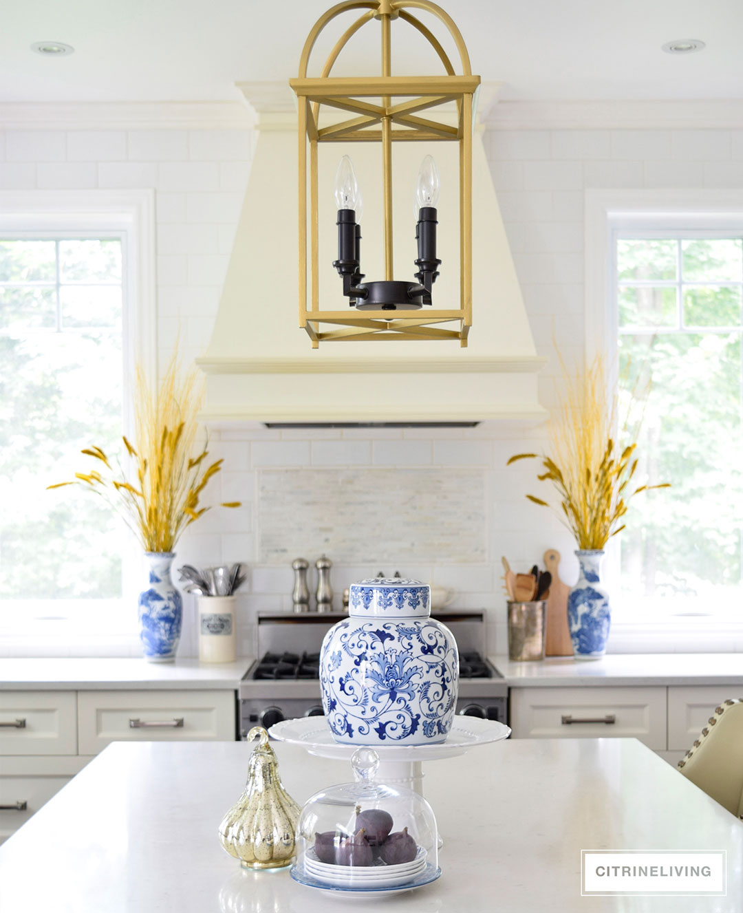 Fall decorated kitchen with blue and white ginger jars, rich gold accents and figs as a decorative element