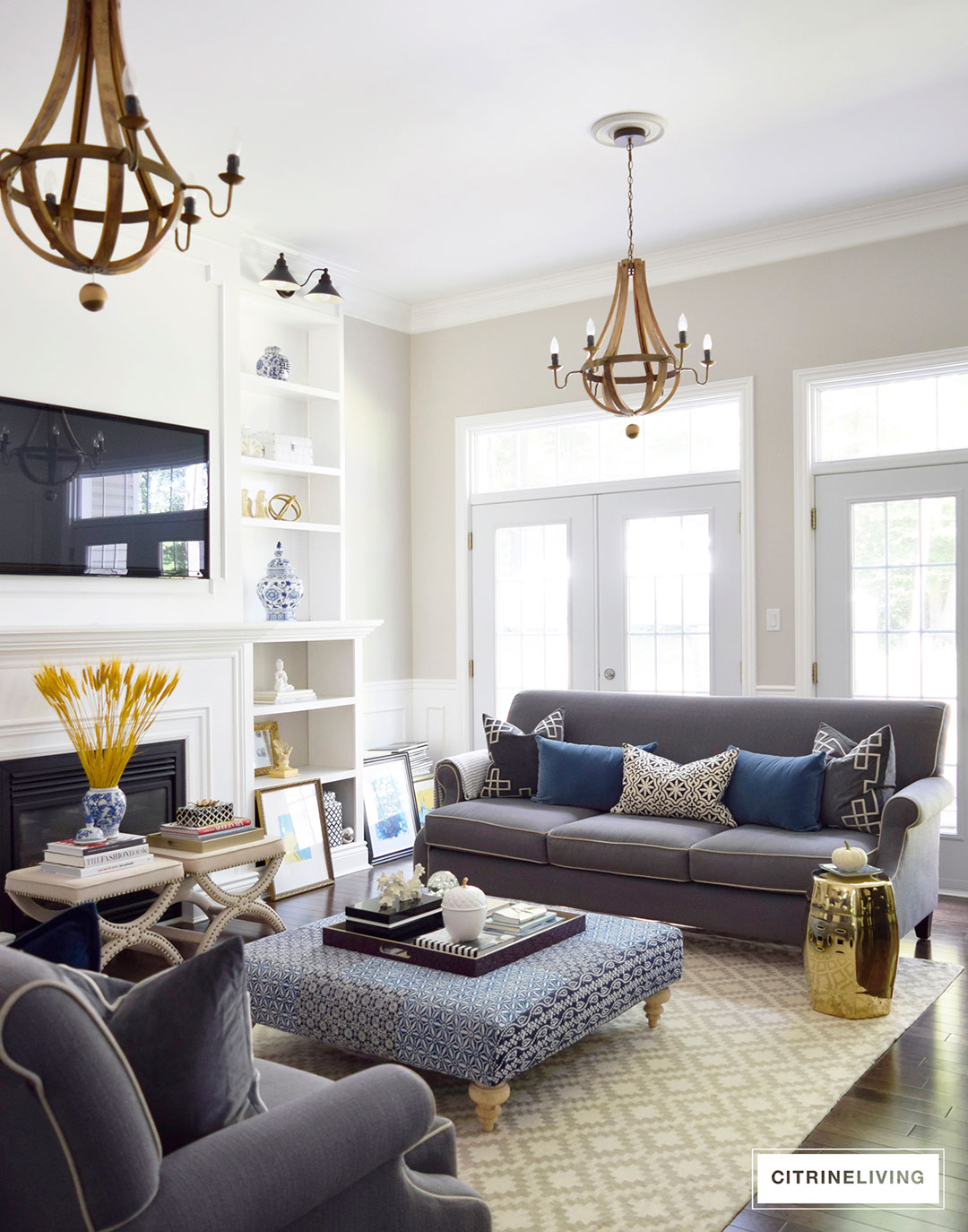 Living room decorated with rich hues of blue, gold and yellow, paired with blue and white for Fall.
