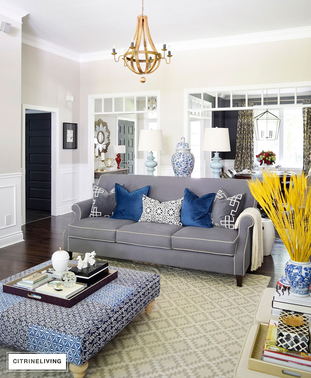 Fall decorated living room featuring rich blue velvet and gold, and blue and white accents