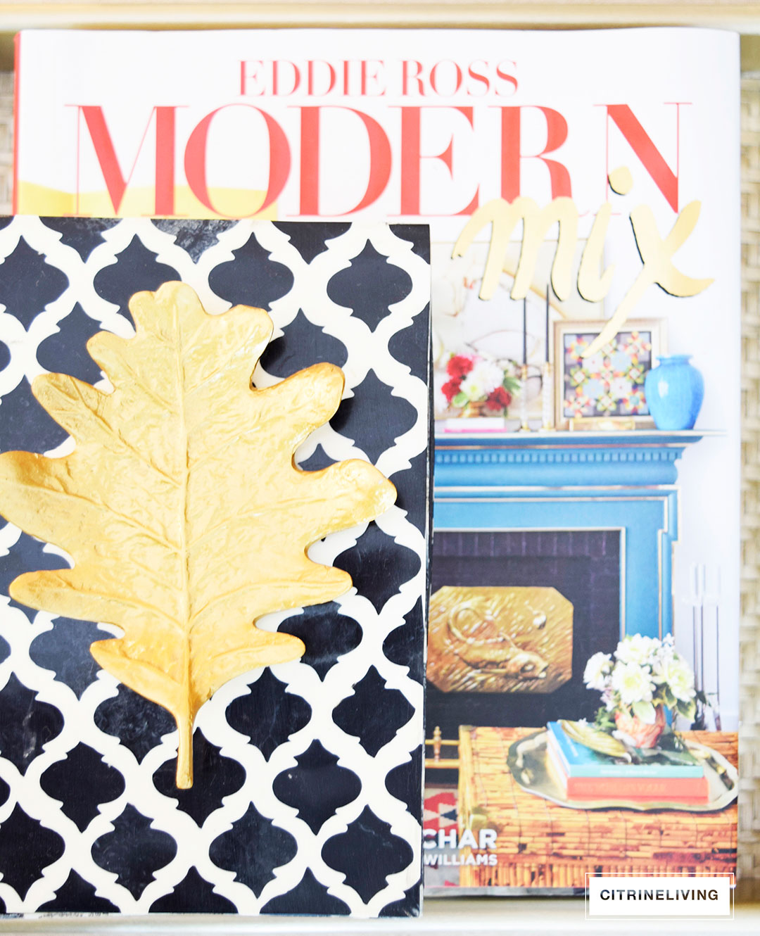 Vibrant design books topped with moroccan inspired decorative box and Fall accents