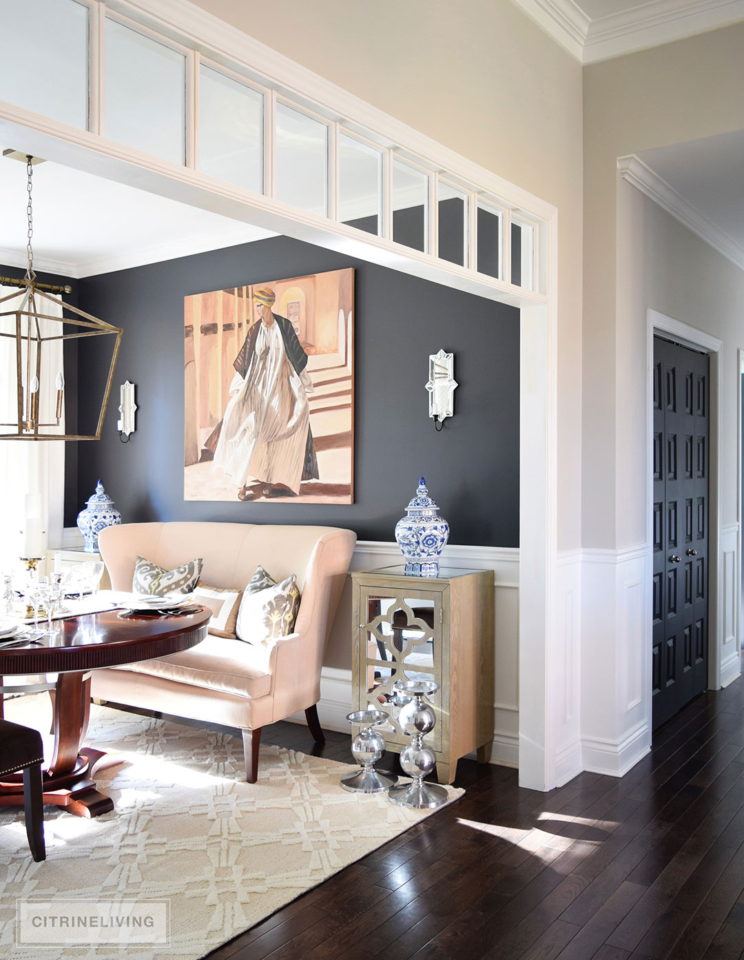 dining-room-black-walls-neutral-rug-beige-settee-ginger-jar