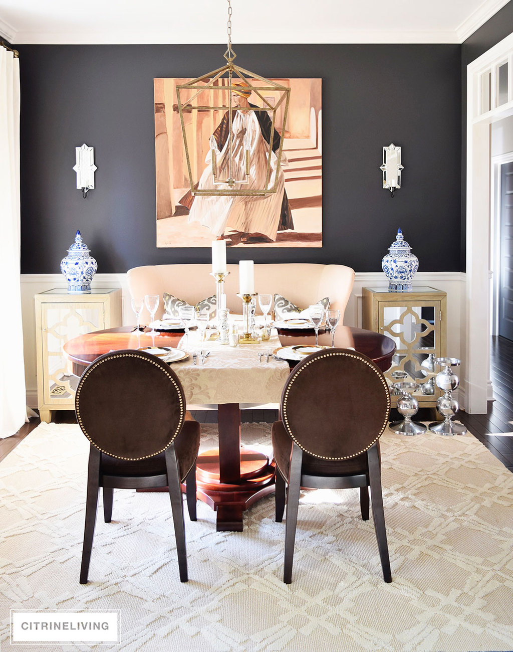 dining-room-black-walls-neutral-rug-brass-pendant