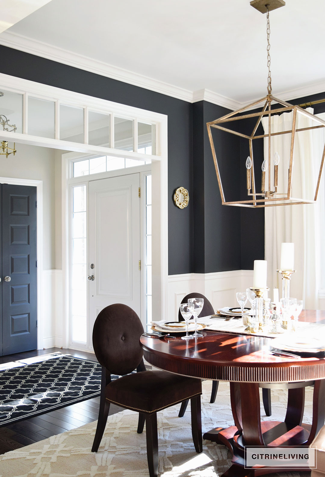 dining-room-black-walls-neutral-rug