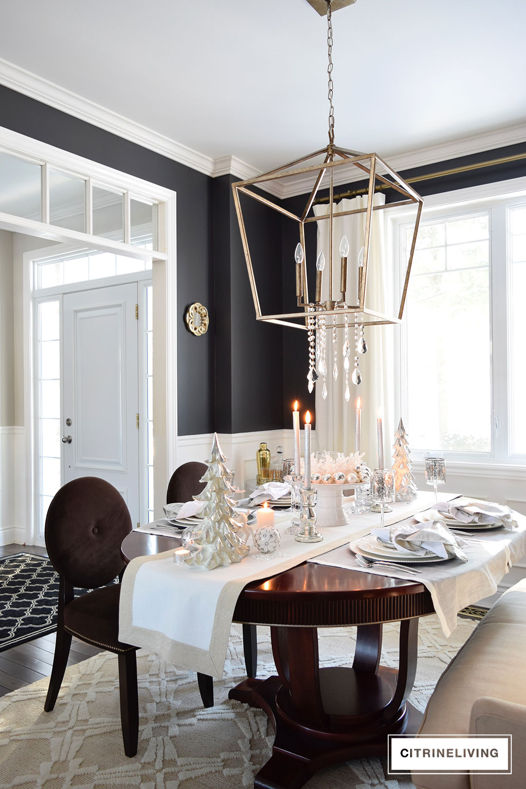 A winter white and silver holiday tablescape for Black dining room walls