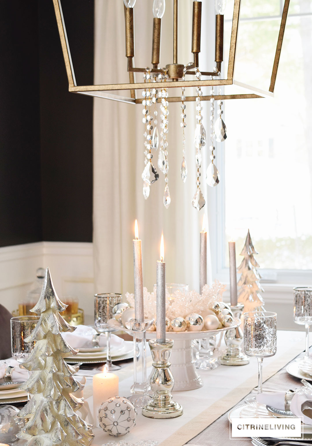 Adding crystals to a modern, lantern style pendant brings chic glam to any space.