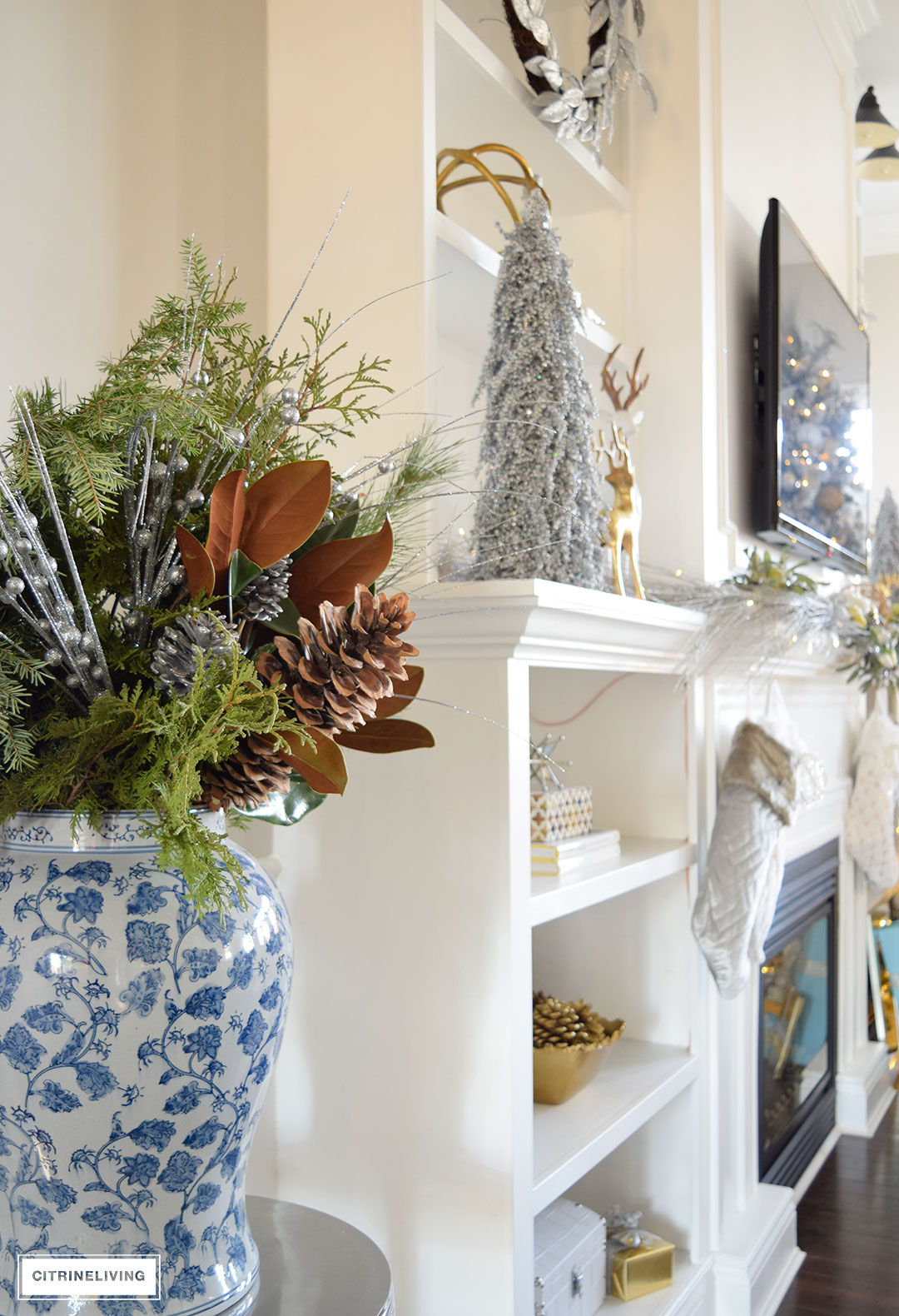 Christmas Home Tour - gorgeous metallics and blue and white e create a chic Holiday theme