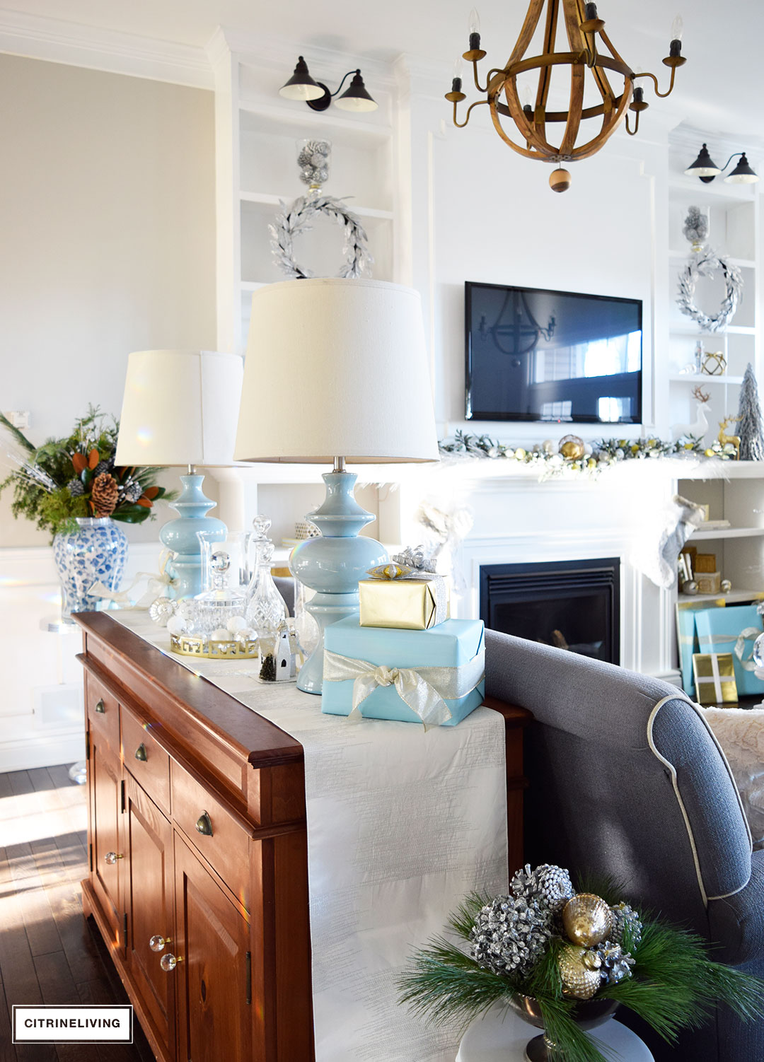 Christmas Home Tour - Gorgeous living room with metallics and icy blue for a perfectly chic Holiday theme