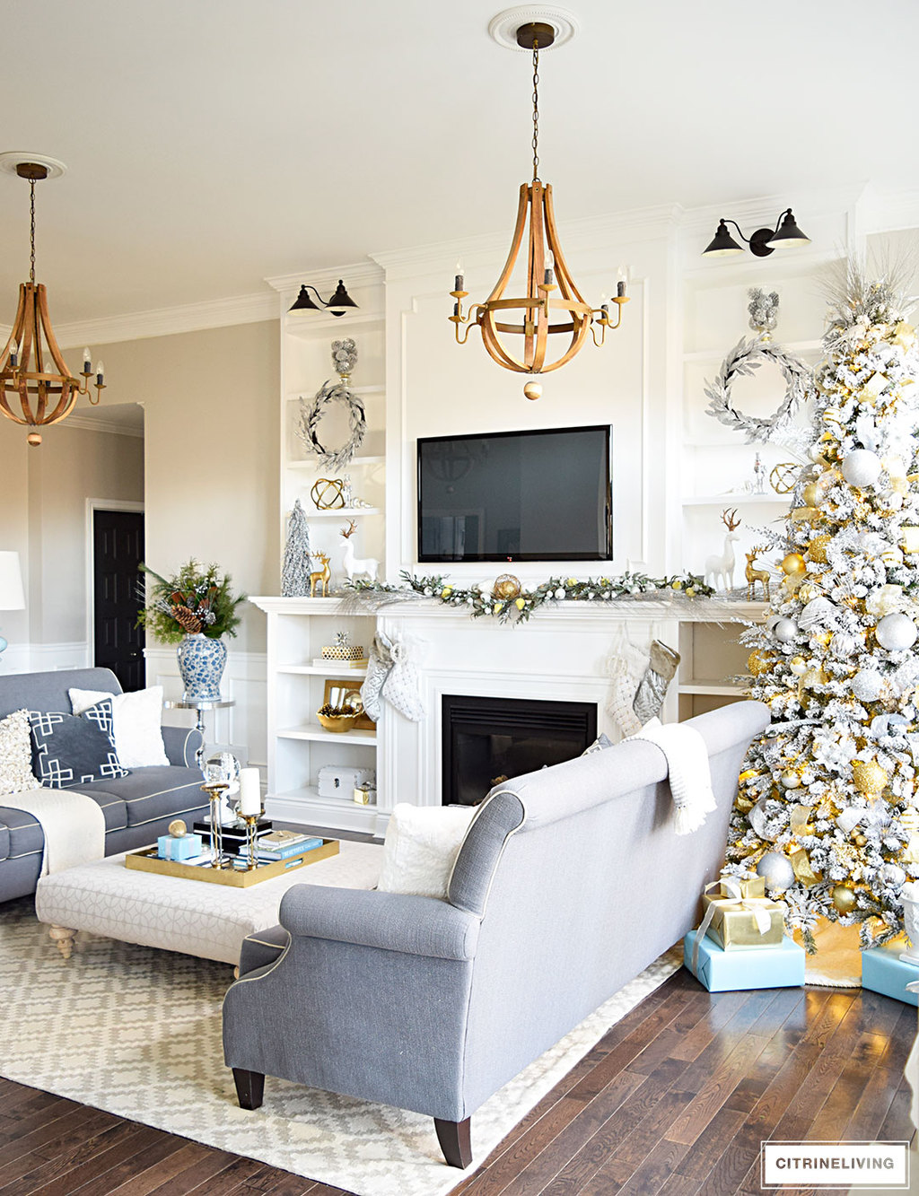 Christmas Home Tour - Gorgeous living room with beautiful metallics and icy blue create a chic Holiday theme