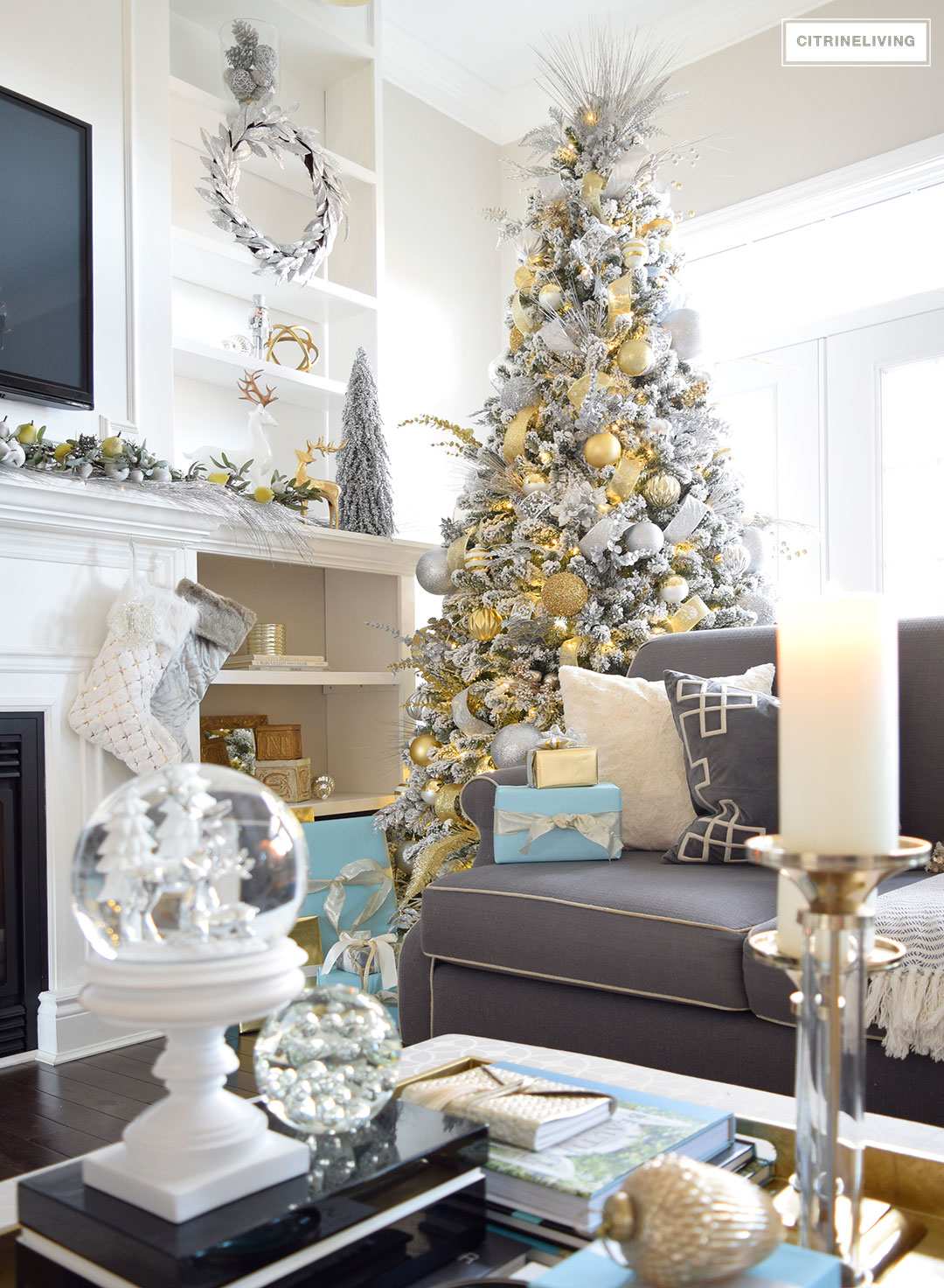 Christmas Home Tour - Stunning flocked Christmas tree with beautiful metallics and icy blue create a chic Holiday theme