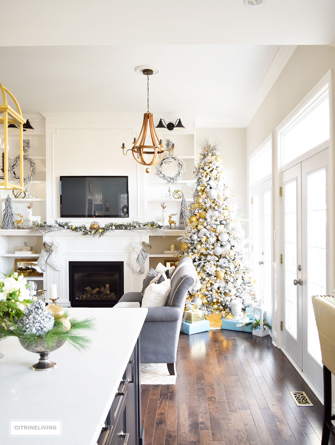 Christmas Home Tour - Stunning flocked Christmas tree with mixed metallics and icy blues accents create a perfectly chic Holiday theme