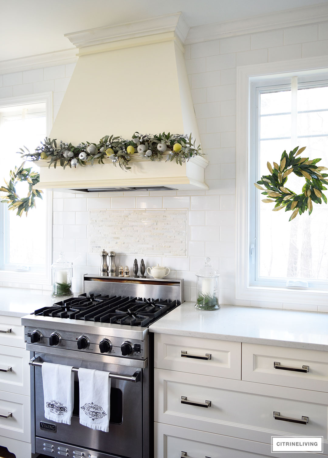 Christmas Home Tour - Elegant kitchen with mixed metallics and holiday greenery create a sophisticated Holiday theme