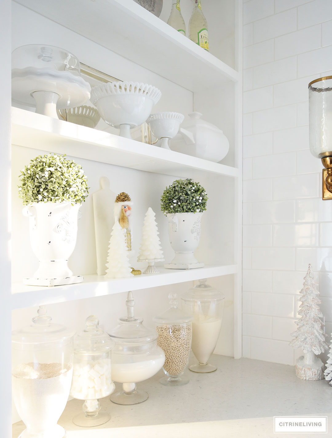 Style your shelves like a pro - keep it simple for the holidays and only decorate one shelf to keep the look from becoming too cluttered.
