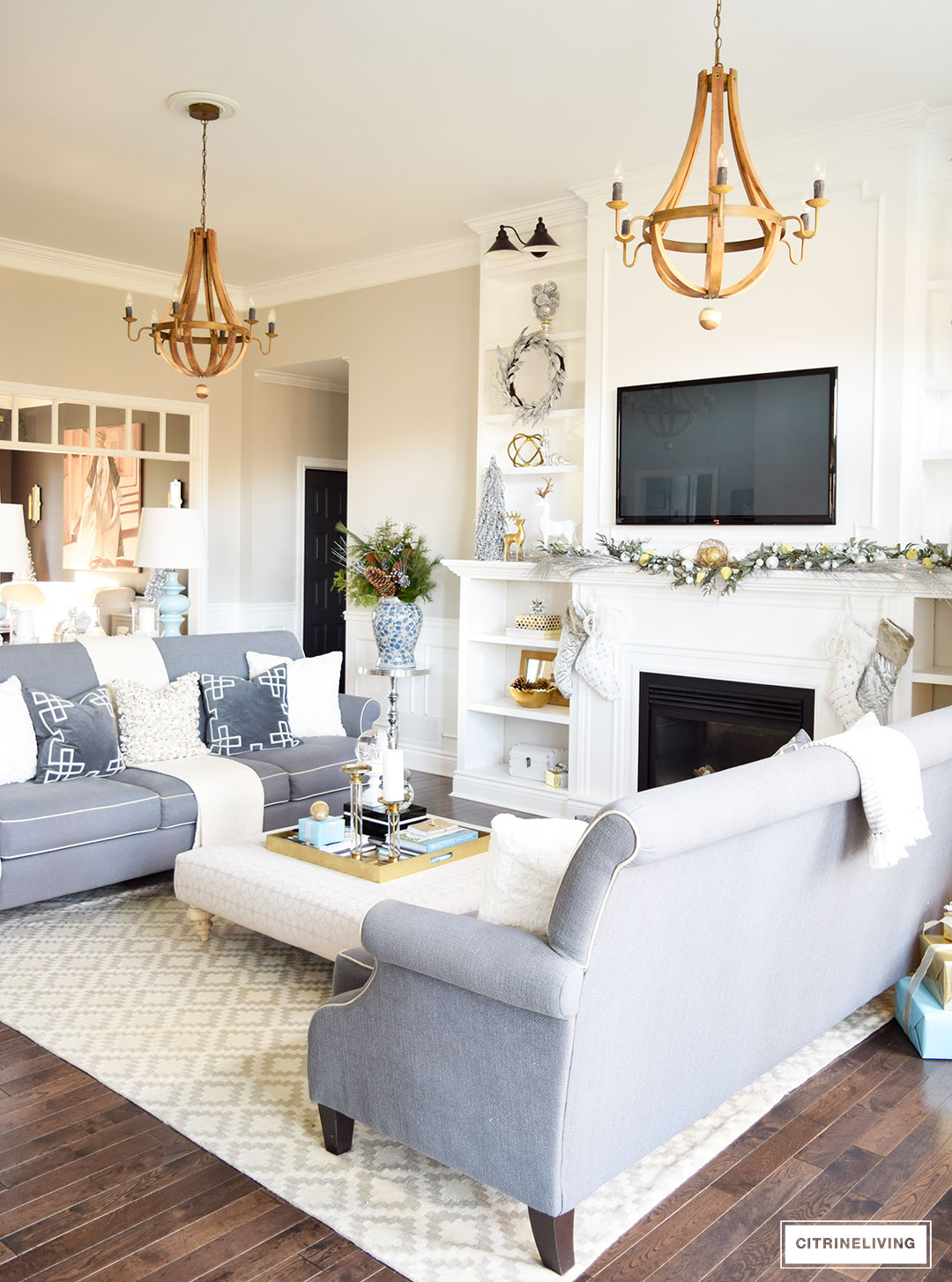 Christmas Home Tour -Gorgeous living room with mixed metallics and icy blue create a chic Holiday theme