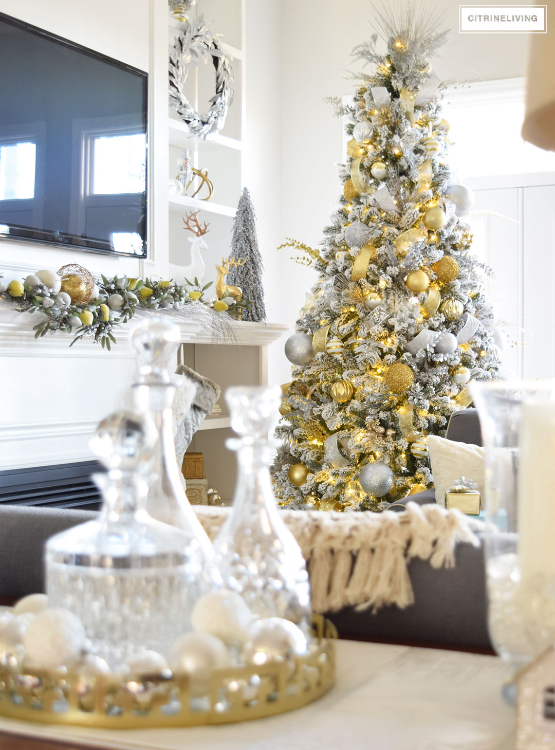 Christmas Home Tour - Stunning flocked Christmas tree with beautiful metallics create a perfectly chic Holiday theme