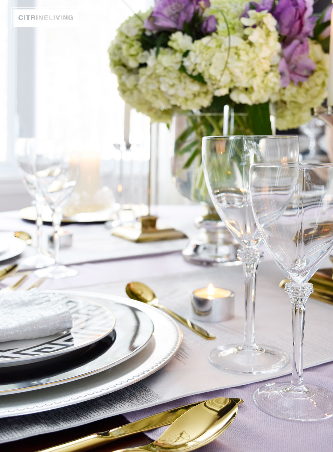 Lavender hues mixed with black and white, along with touches of metallics are a fresh take on a Valentine's Day tablescape for four.