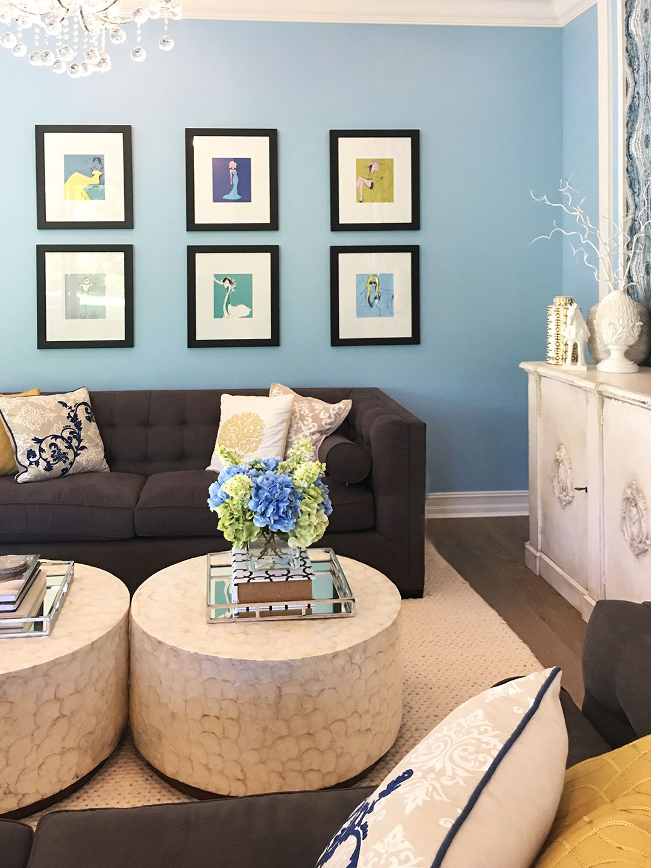 family-room-grey-sofa-chandelier-blue-walls