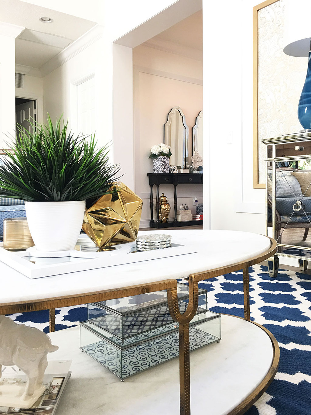 marble-cofee-table-gold-accents-blue-rug