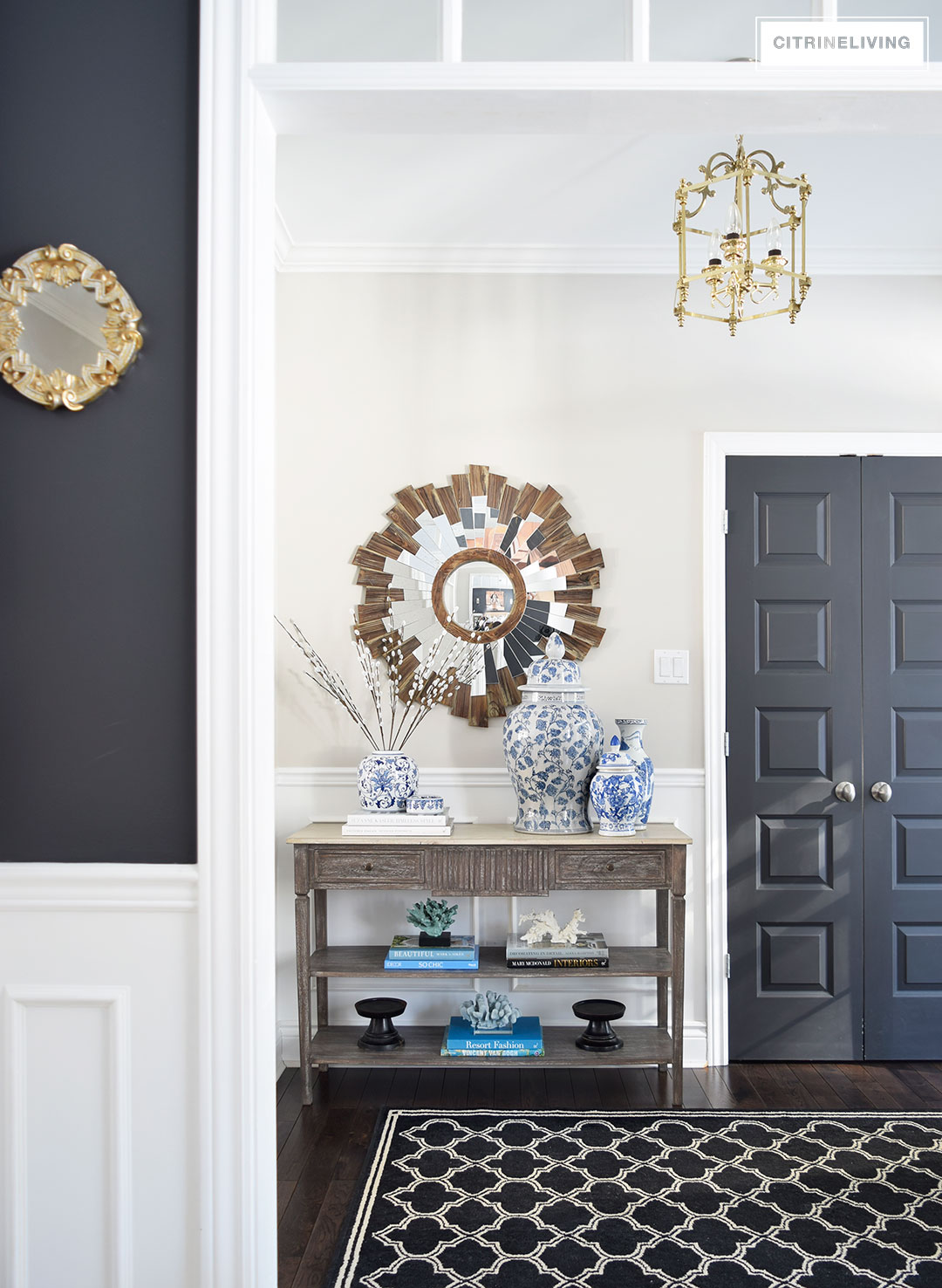 ONE TABLE FOR WAYS : Shop your own home to create unique and new styling displays | BLUE AND WHITE| GINGER JAR | WOOD CONSOLE TABLE | STARBURST MIRROR | ENTRYWAY | FOYER | BLACK WALLS | BLACK DOORS