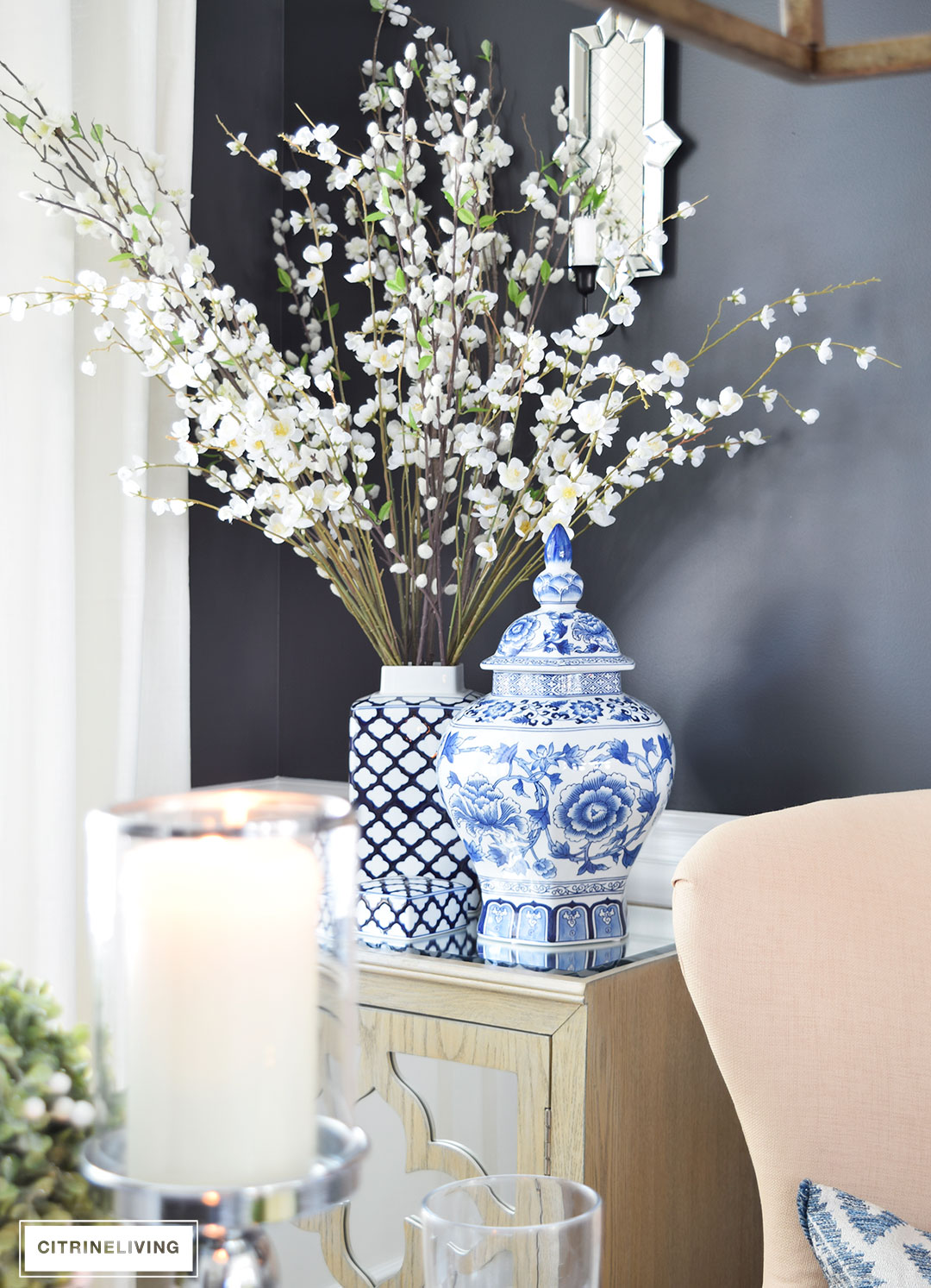 Blue and white ginger jars with a mix of Spring branches are an elegant addition to any space.