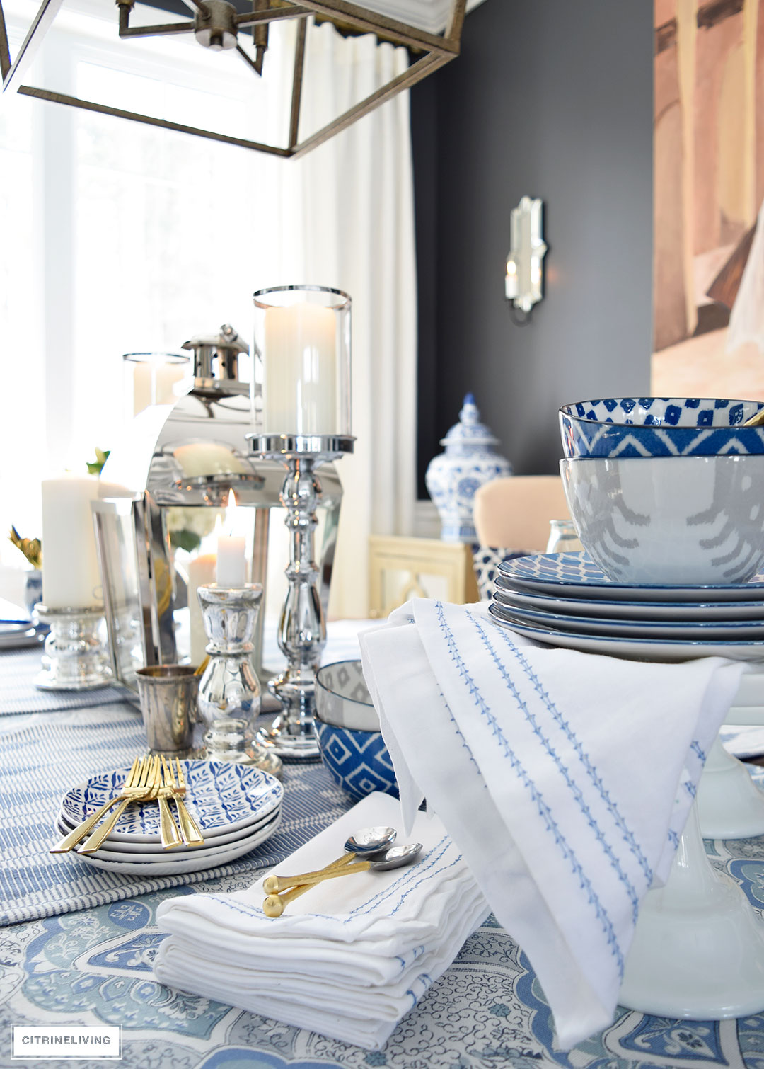 A mix of blue and white linens and dishes paired with mixed metal accessories is perfect for an elegant Spring table.