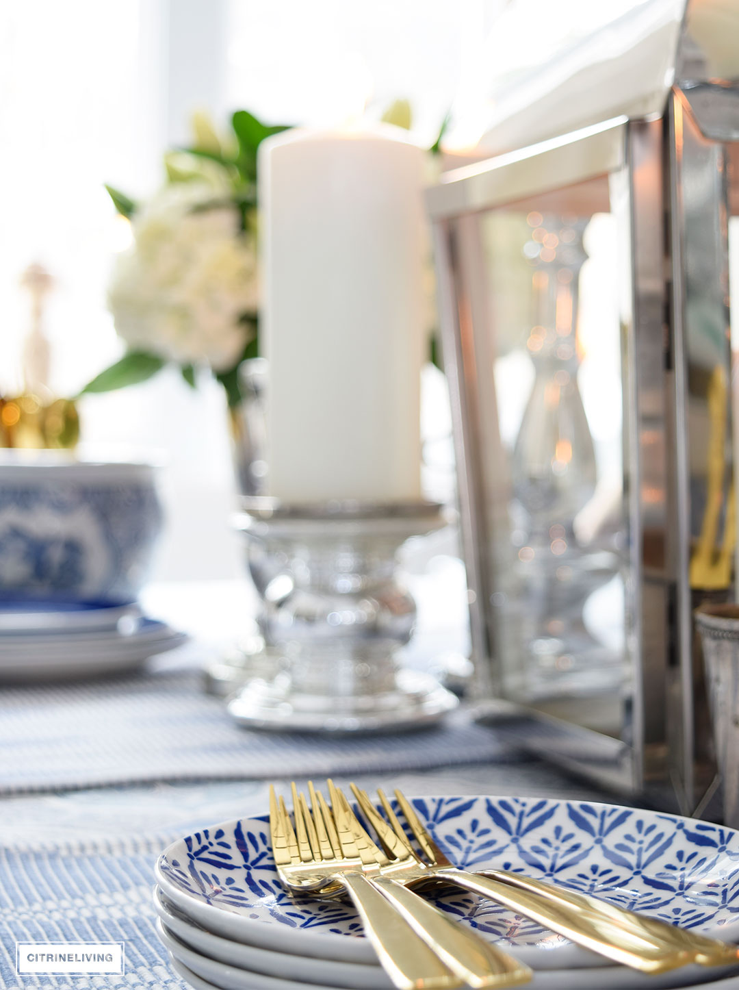 Gold flatware and blue dishes is always fresh for Spring.