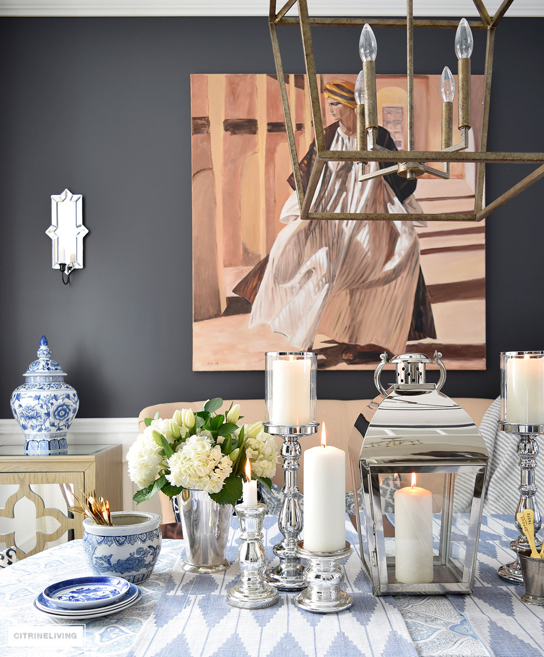 Fresh flowers and layers of blue and white pattern with silver candleholders and gold flatware is perfect for a Spring table.
