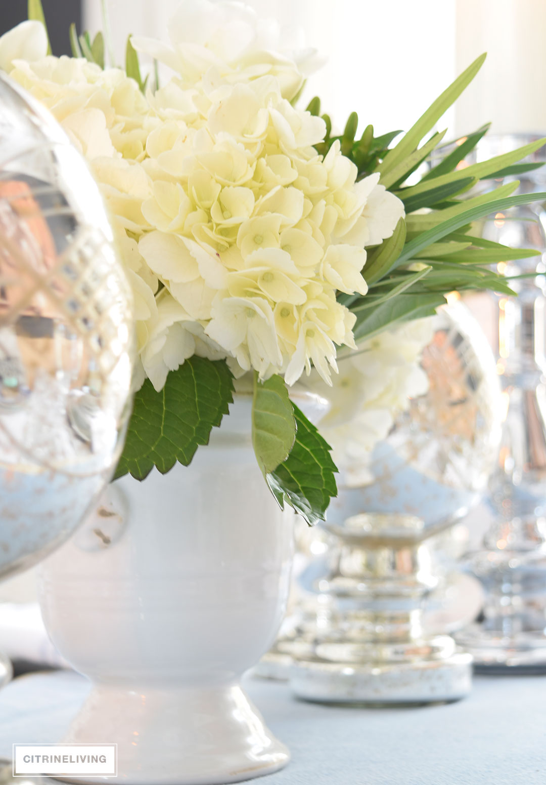 Simple and classic fresh hydrangeas are always the perfect centerpiece for any table.