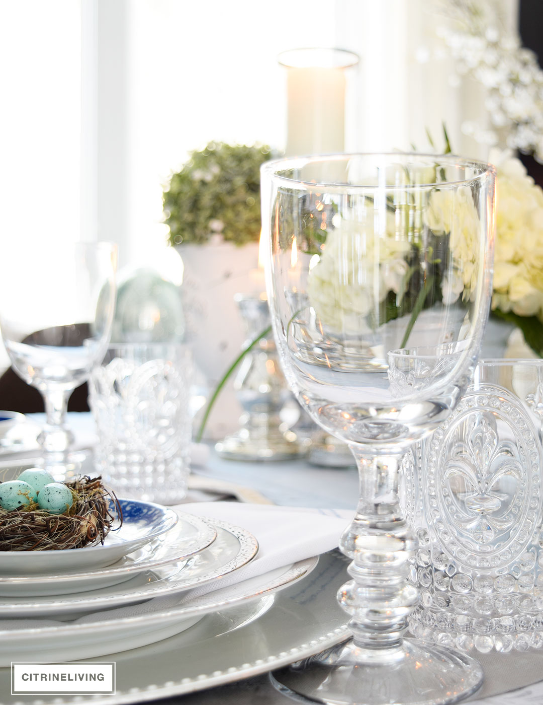 Fleur De Lys glasses and stemmed water goblets add sparkle to this elegant Easter tablescape.