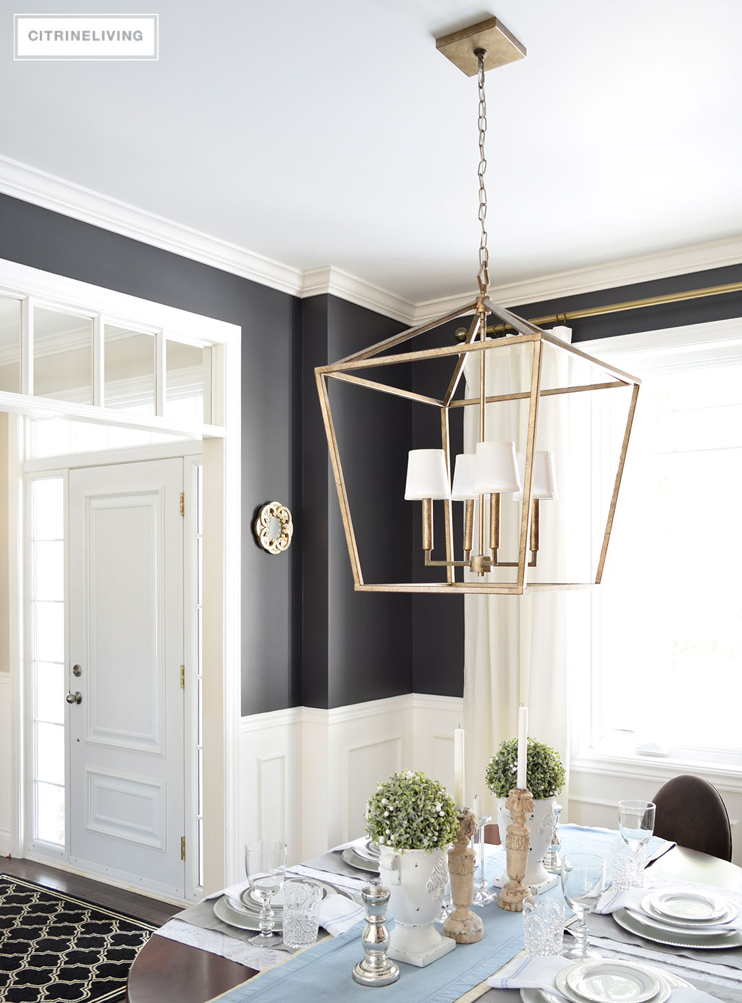Three simple tips to customize your light fixtures a lantern style chandelier gets an elegant update with the addition of white chandelier shades arubaitofo Choice Image
