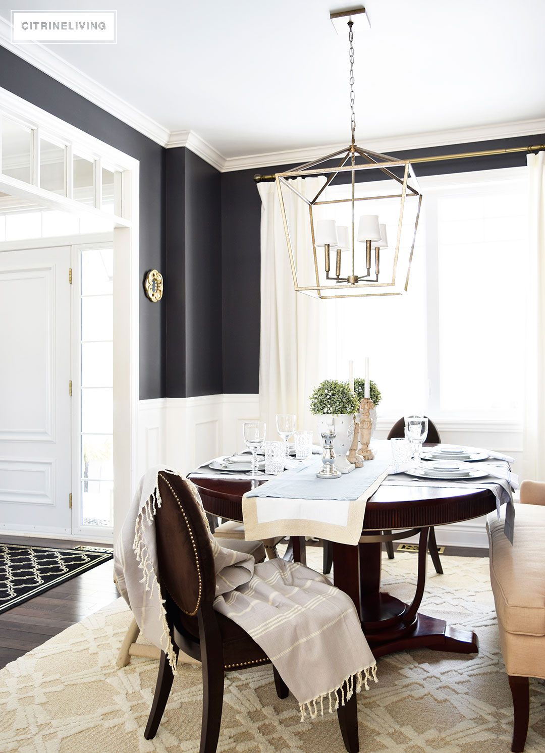 A lantern style chandelier gets an elegant update with the addition of white chandelier shades.