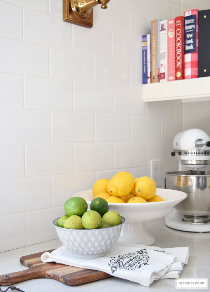 Add the perfect touch for the Spring and Summer seasons with vibrant lemons and limes in displayed in pretty bowls.