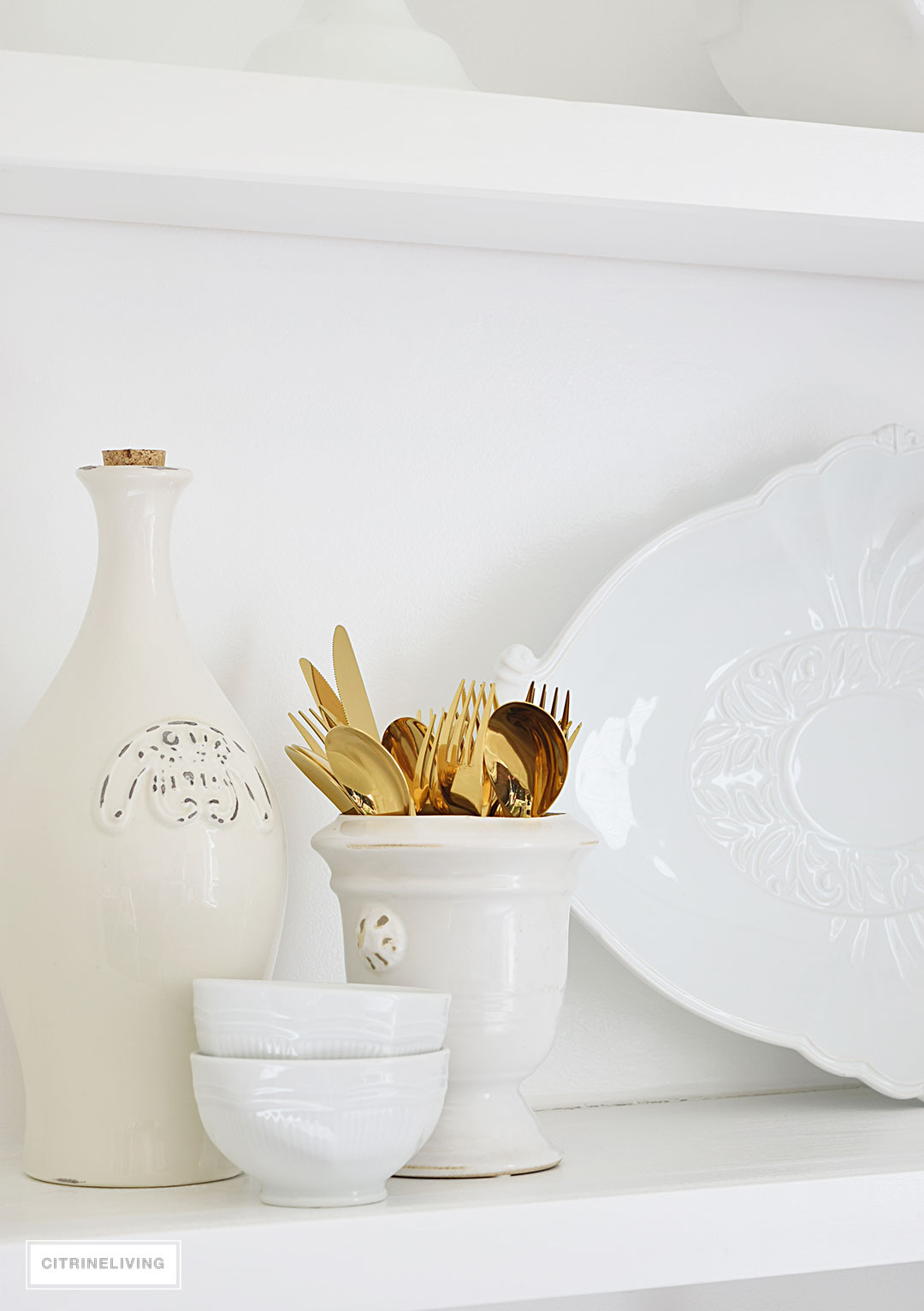 Layers of white and neutral accessories and serving pieces creates a clean look in any kitchen.