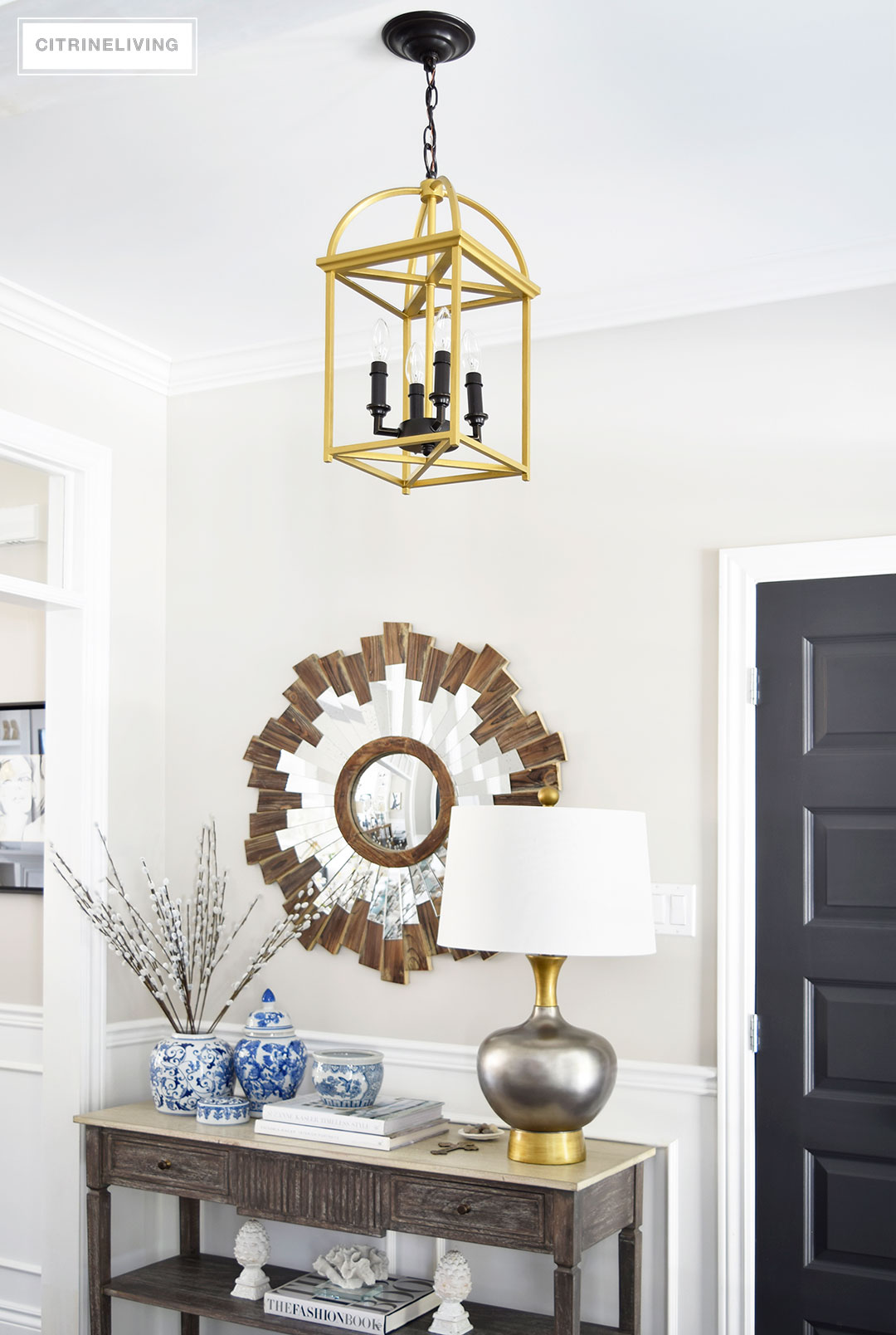 A two-toned brass and black lantern is the perfect addition to an entryway or hallway.