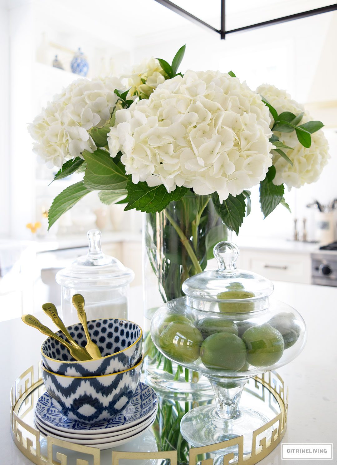 Bright and airy kitchen with fresh produce and blue and white accessories - add the perfect touch for the Spring and Summer seasons.