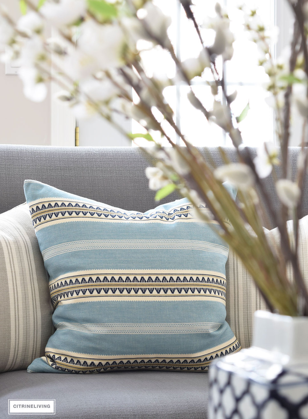 Beautiful Henderson Stripe pillow in sky from Tonic Living. Bring freshness to your home this Spring with layers of beautiful blues, fresh and faux florals, and new modern art and textiles.