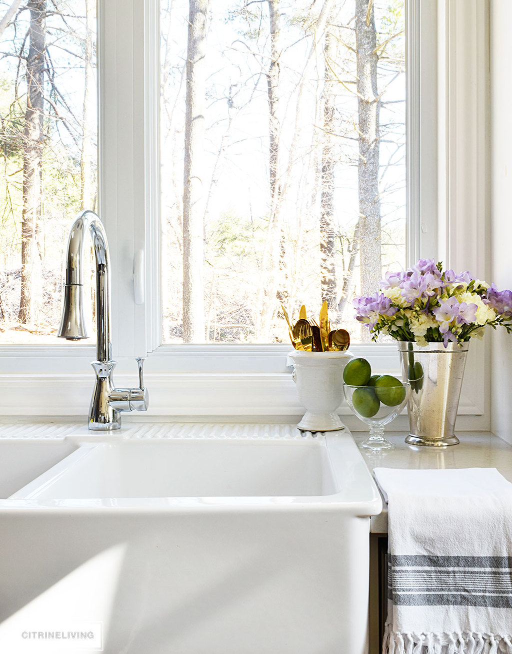 Beautiful Spring flowers - hydrangeas and freesias - paired with fresh limes, creates a vibrant vignette on the in your kitchen.
