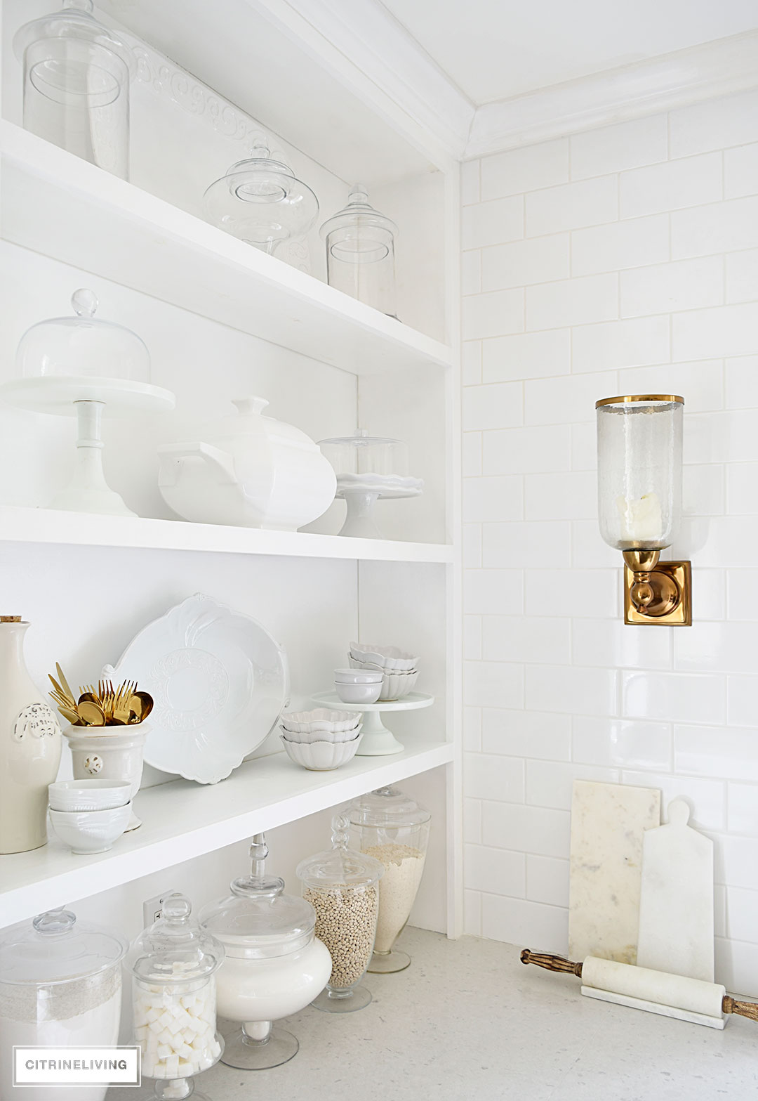 Bring vintage flair to your open kitchen shelving with a mix of white and cream serving pieces and dishware for a fresh, layered look.