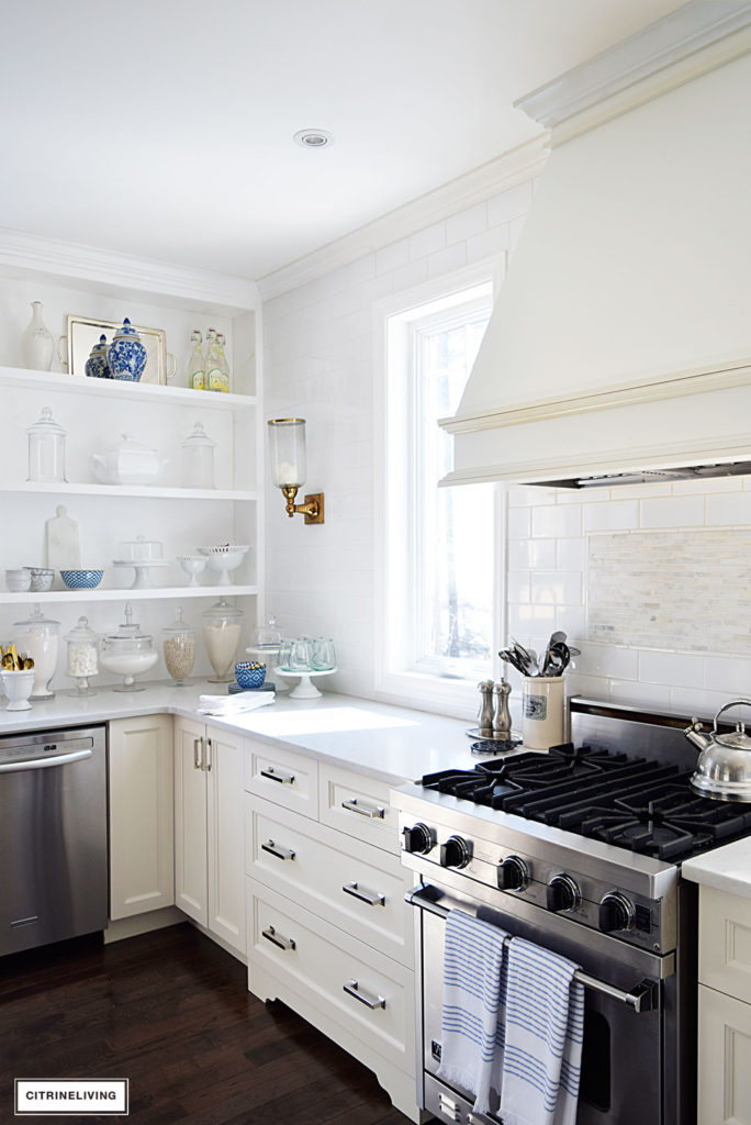 Bright and airy kitchen with blue and white accessories - add the perfect touch for the Spring and Summer seasons.