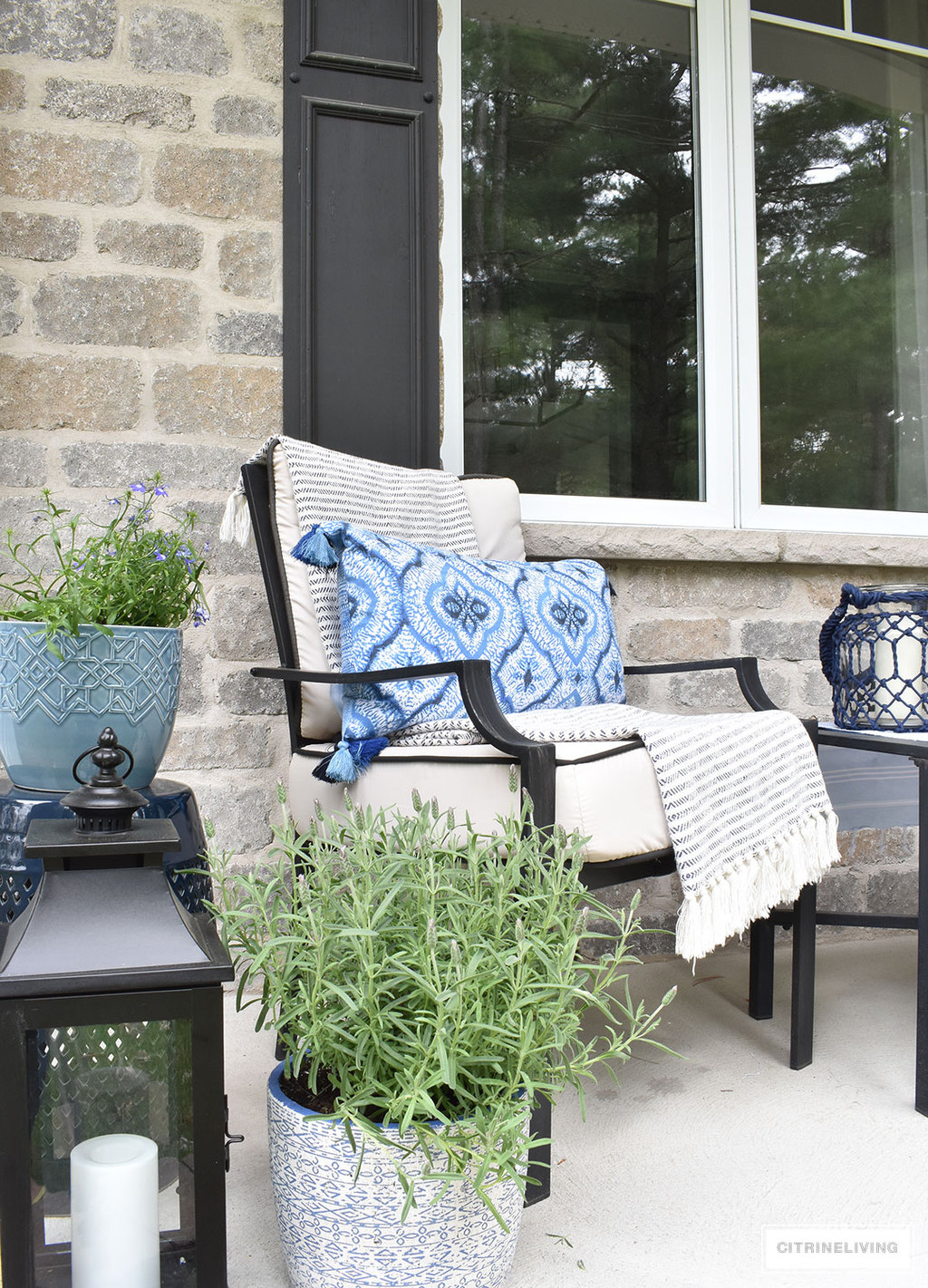 Create a chic Spring porch decorated with blue and white accents: garden stools, potted plants with some boho-chic and nautical pieces thrown into the mix!