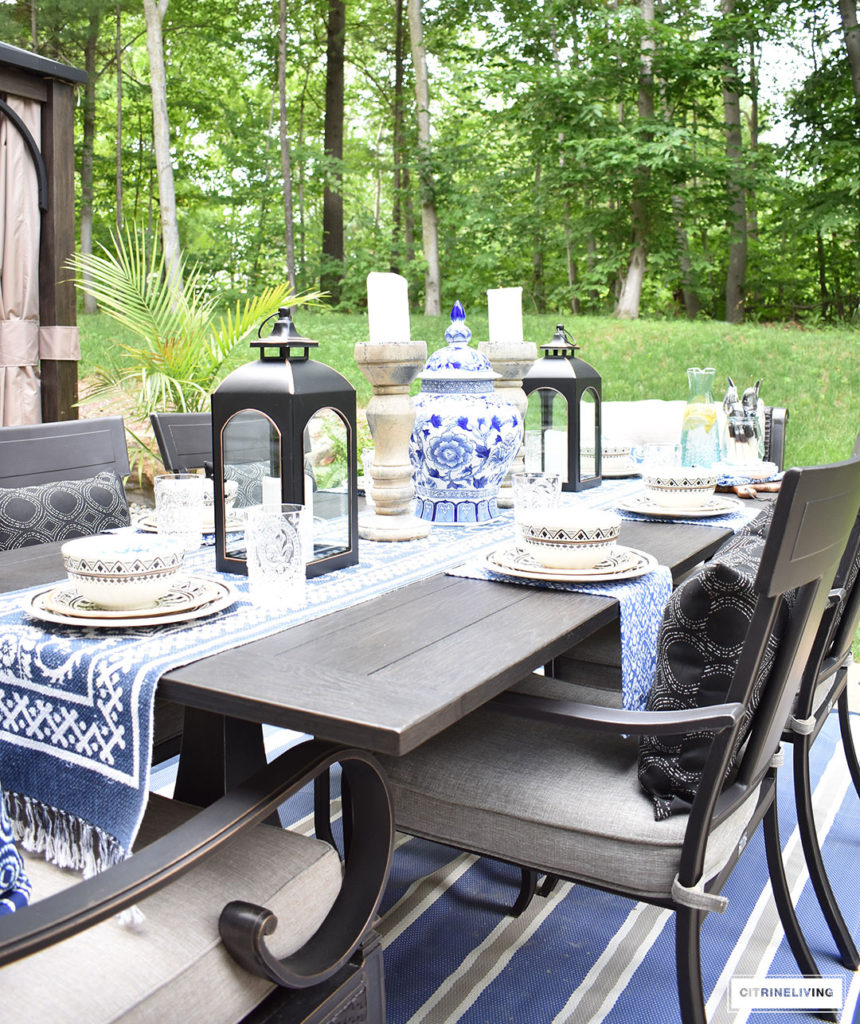 Blue and white accessories and linens paired with Moroccan inspired outdoor dishware are the ideal compliment for al fresco entertaining! Keep the look classic with ginger jars, lanterns and candles arranged symmetrically.