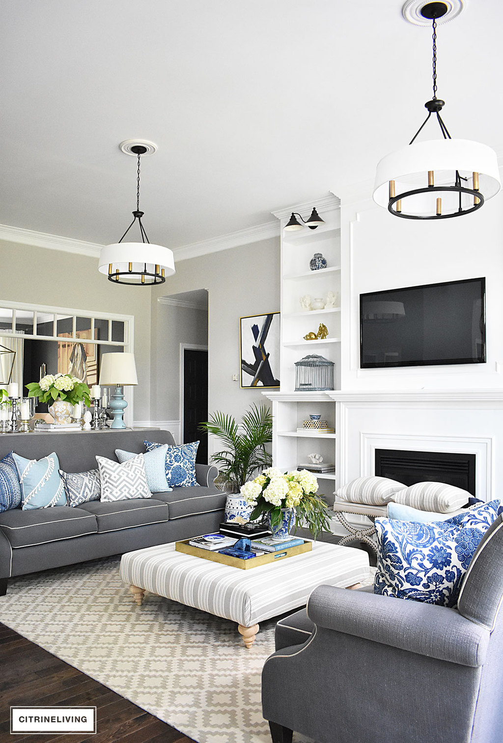Summer home tour with beautiful blues and fresh greenery Black white blue living room