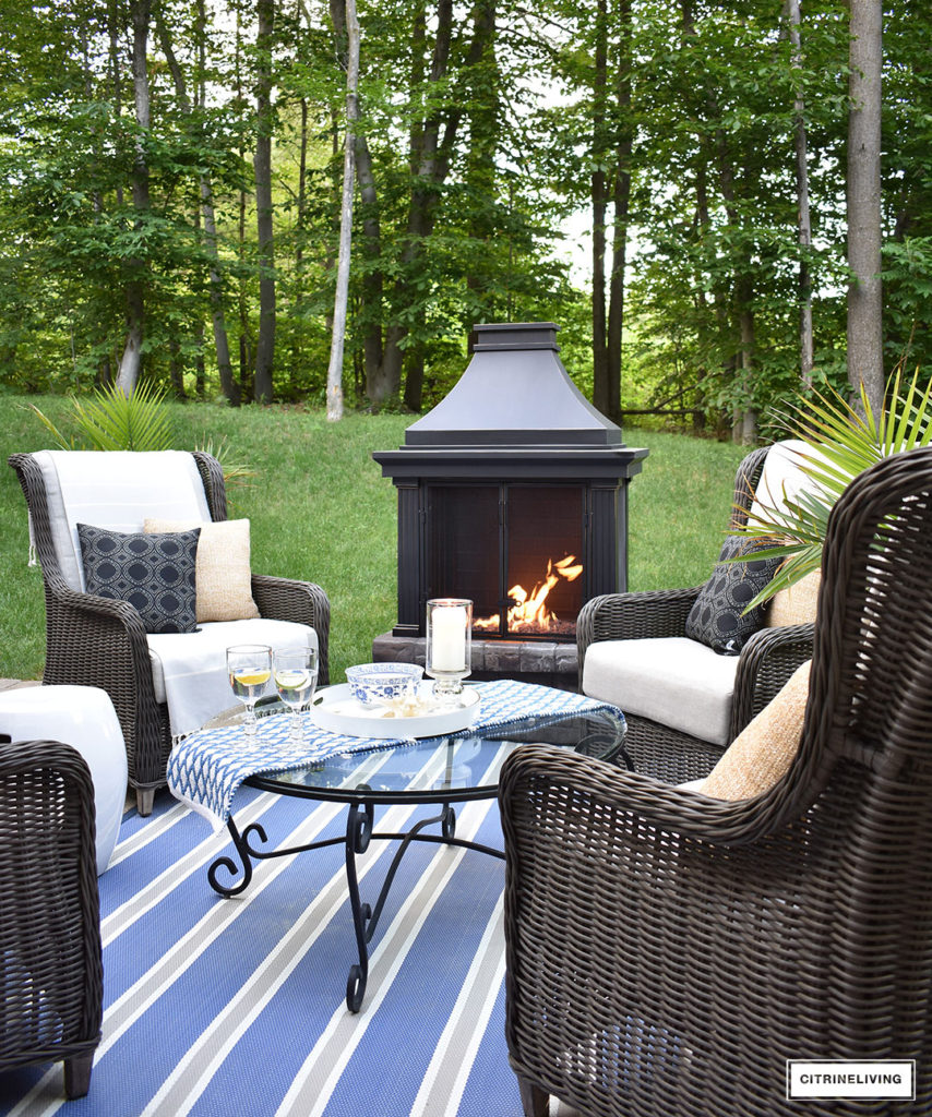 Create a warm and inviting conversation area on your patio this Summer with a gorgeous fireplace and resin wicker wingback chairs. Perfect for gathering with friends and family, to relaxing in the mornings with coffee!