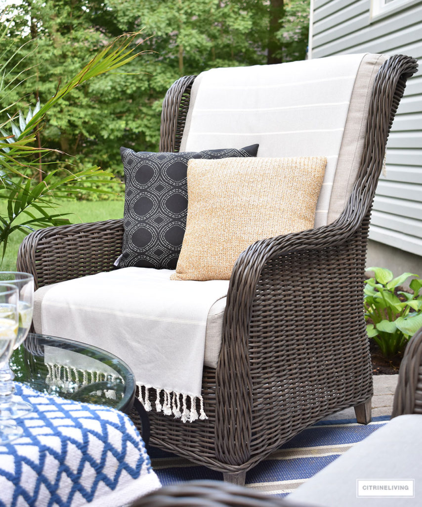 Beautiful, resin wicker wingback chairs are the perfect spot to relax and enjoy coffee or a beverage in your backyard this Summer!