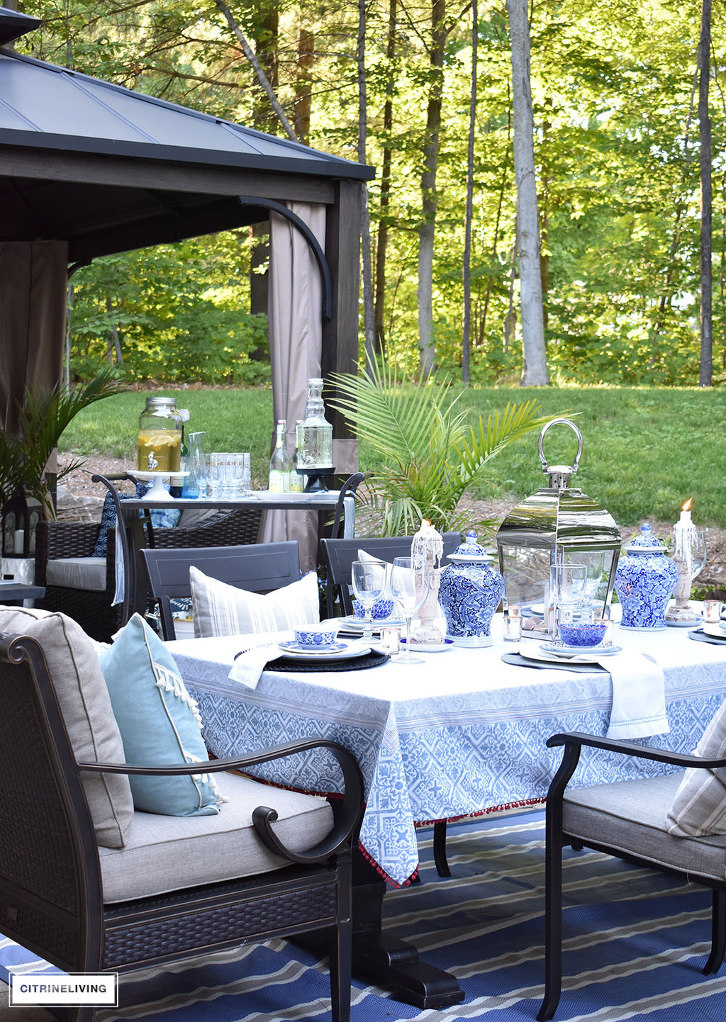 Layers of blue and white mixed with pattern and texture is a key element in this outdoor setting.