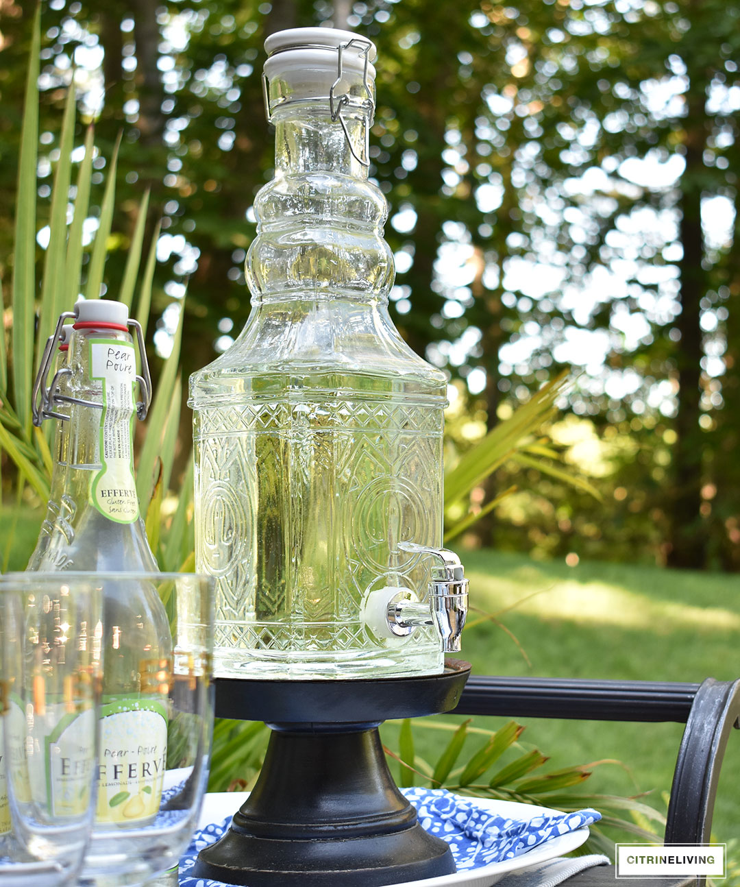 Use an outdoor bar cart layered with vintage inspired glassware and drink dispensers for your Summer entertaining.