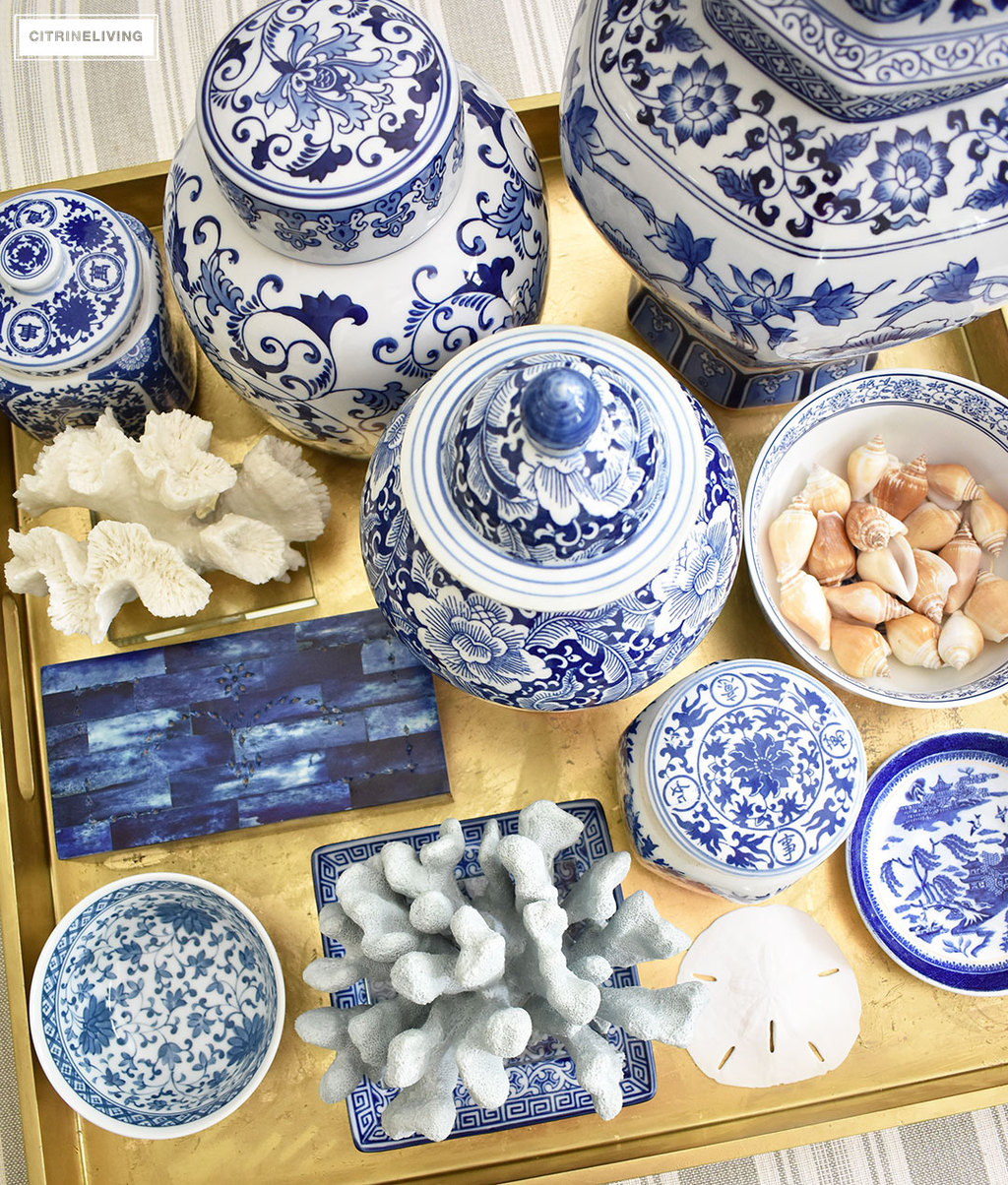 A collection of blue and white ginger jars, dishes and vases, paired with coastal elements is fresh and current as well as timeless and classic.