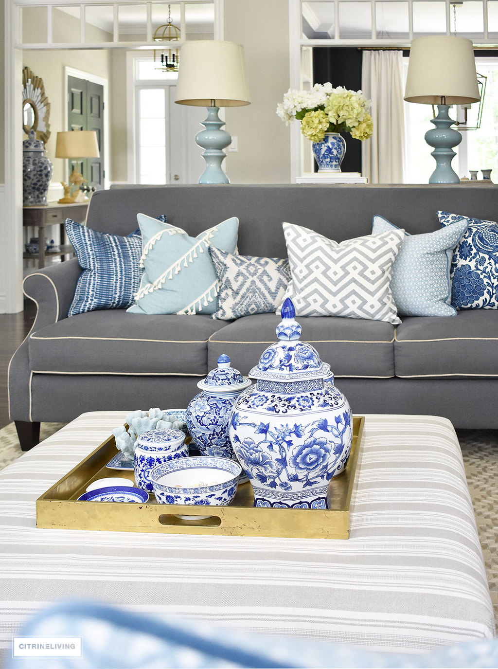 3 ways to style your coffee table or ottoman style your coffee table with a clustered grouping of blue and white ginger jars and accessories geotapseo Images