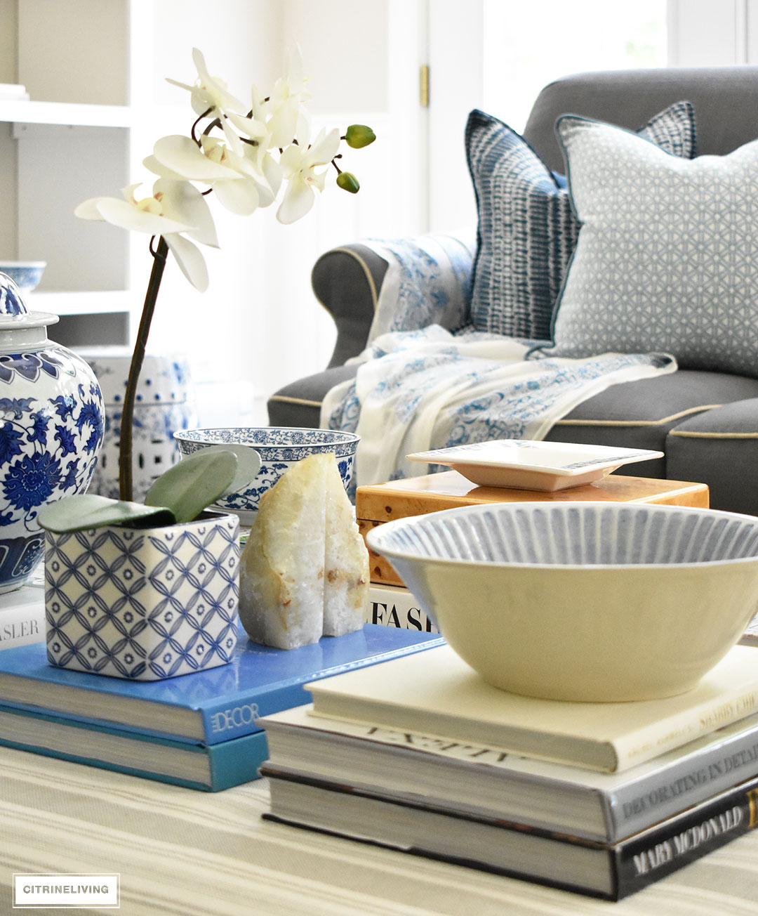 3 ways to style your coffee table or ottoman make a style statement on your coffee table with stacks of books decorative boxes and geotapseo Images